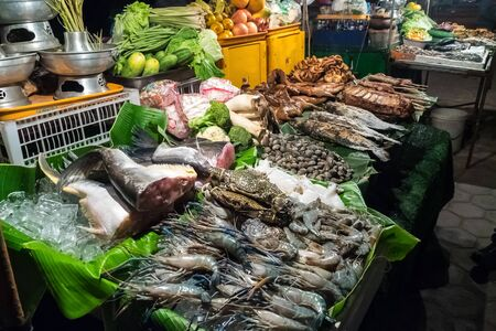 Asian food market in Vientiane in Laos, Asia
