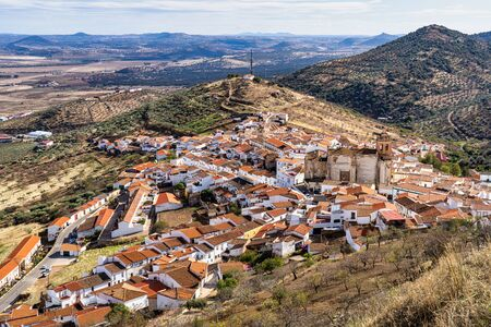 Little village of Feria with church of San Bartolome. Extremadura in Spain. Stock Photo