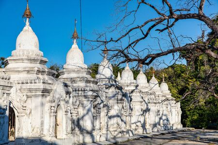 The White stupa temple of Kuthodaw in Mandalay, Myanmar, former Burma in Asia Stock Photo