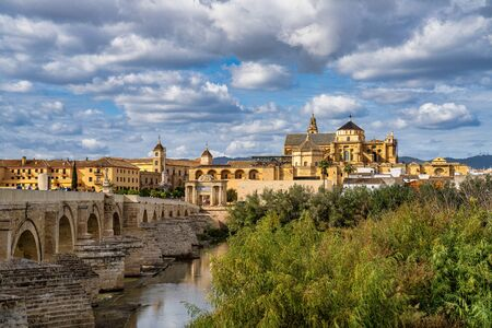 Mosque-Cathedral and the Roman Bridge in Cordoba, Andalusia, Spain Stock Photo