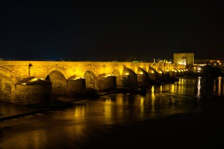 Roman bridge with Calahorra Tower at night in Cordoba, Andalusia, Spain
