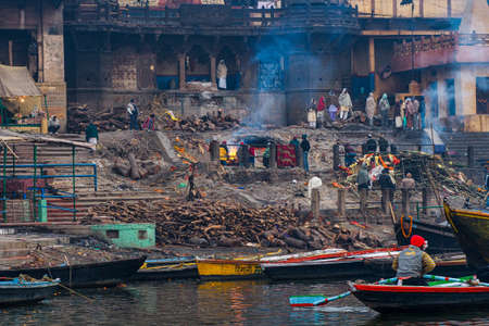 Varanasi, India - Dec 26, 2019: Cremation of bodies at the holiest Manikarnika Ghat on the banks of the Ganges river in Varanasi, India. Editorial