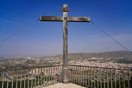 Famous cross at La Virgen del Buen Suceso Sanctuary in Cieza in Murcia region, Spain with view over the town Cieza