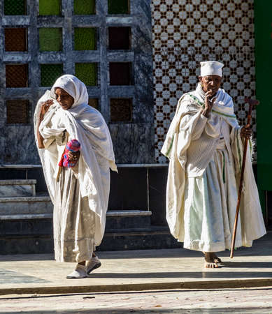 Aksum, Ethiopia - Feb 09, 2020: Ethiopian People at Church of Our Lady St. Mary of Zion, the most sacred place for all Orthodox Ethiopians in Axum, Ethiopia. Stockfoto - 143146580