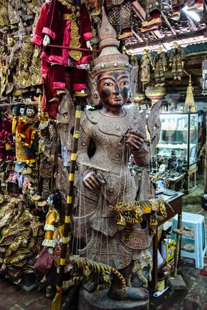 Traditional handicraft puppets are sold in a market at Mandalay, Myanmar.