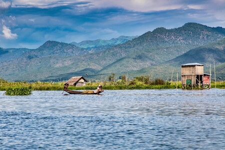 Wooden floating houses on Inle Lake in Shan, Myanmar, former Burma in Asia