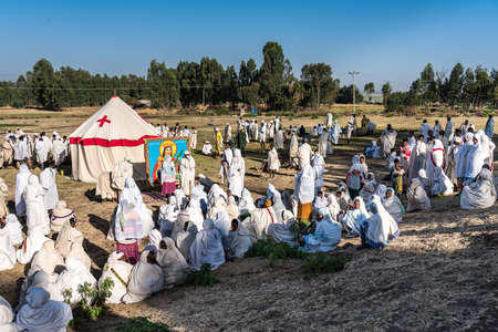 Gondar, Ethiopia - Feb 06, 2020: Ethiopian people at a mass at the surrounding area of Gondar in Ethiopia, Africa