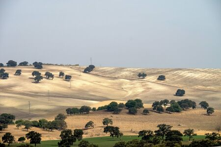 View of the fields and countryside over Embalse de Guadalcacin, near the town of San Jose del Valle, within the Parque natural de la Sierra de Grazalema, Andalucia, Spain