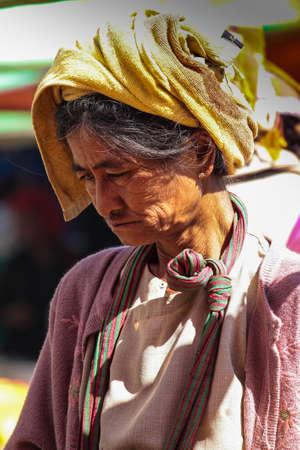 Heho, Myanmar - Nov 08, 2019: People at a market in the city center of Heho in Myanmar, former Burma in Asia