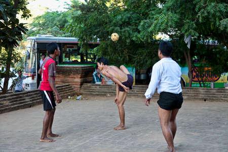 Bagan, Myanmar - Nov 15, 2019: Burmese men playing the traditional ball game of Myanmar: Chinlone.