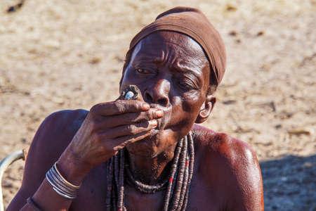 Opuwo, Namibia - Jul 07, 2019: Old Namibian man smoking a cigar, seen in Opuwo, the capital of the Kunene Region in north-western Namibia, Africa