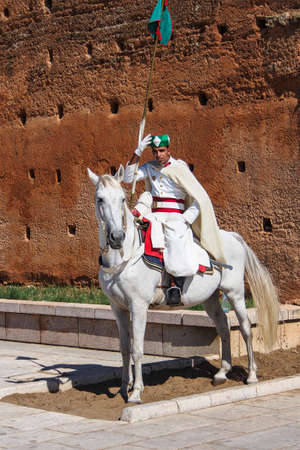 Rabat, Morocco - Oct 13, 2019: A royal maroccan guard in front of the mausoleum of the Mohammed V next to the Hassan Tower Redactioneel