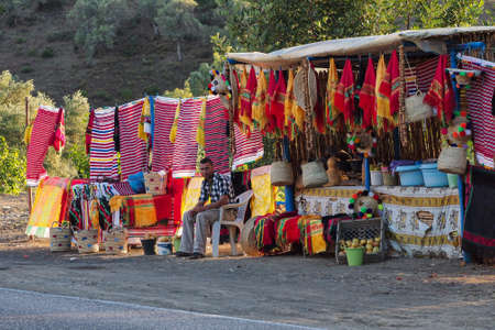 Fes, Morocco - Oct 14, 2019: View of a weekly Berber souk market bazaar held in the countryside. A bustling scene of locals at a weekly souk outside of Fes