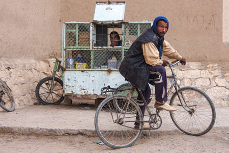 Erfoud, Morocco - Oct 17, 2019: People on alley, streetlife in Ksar Maadid, Erfoud, Rissani, Morocco in Africa