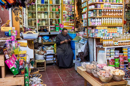 Marrakesh, Morocco - Oct 22, 2019: People at the Marrakesh souk, the largest traditional market in Morocco, with 18 souks selling wares ranging from traditional Berber carpets to modern electronic Redactioneel