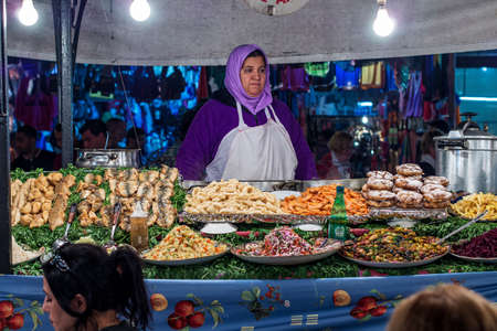 Marrakesh, Morocco - Oct 22, 2019: Jemaa el Fna market square in Marrakesh, Morocco, north Africa. Jemaa el-Fnaa, is a famous square and market place in Marrakesh's medina