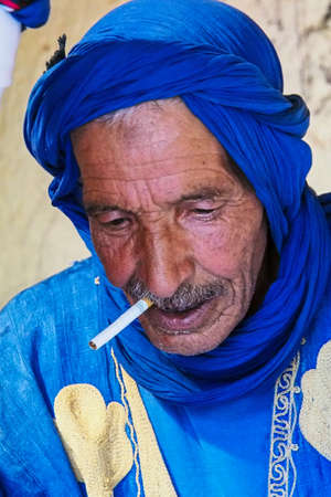 Erfoud, Morocco - Oct 17, 2019: Old Berber man living in the moroccan mountains in Ksar Maadid near Erfoud in Morocco, Africa