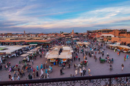 Marrakesh, Morocco - Oct 21, 2019: Jemaa el Fna market square with Koutoubia mosque, Marrakesh, Morocco, north Africa. Jemaa el-Fnaa, is a famous square and market place in Marrakesh's medina