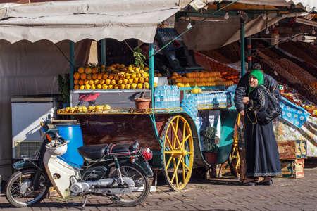 Marrakesh, Morocco - Oct 22, 2019: People at Jemaa el Fna market square in Marrakesh, Morocco, north Africa. Jemaa el-Fnaa, is a famous square and market place in Marrakesh's medina