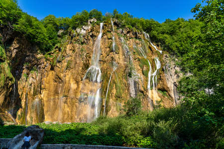 Majestic view on waterfall with turquoise water in the Plitvice Lakes National Park, Croatia. Europe. One of the oldest and largest national parks in Croatia. Фото со стока