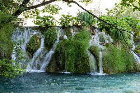 Majestic view on waterfall with turquoise water in the Plitvice Lakes National Park, Croatia. Europe.