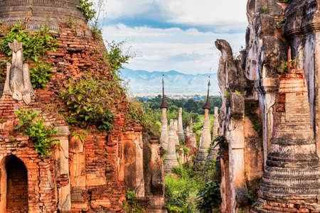 Ruins of ancient stupas of Shwe Indein Pagoda over blue sky. Indein village, Inle Lake, Shan State, Myanmar, Burma