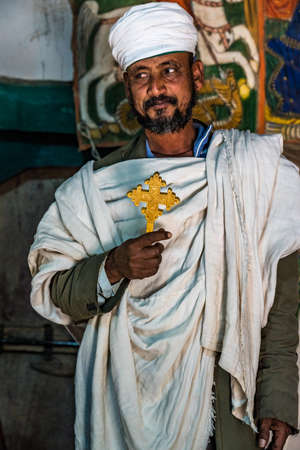 Yeha, Ethiopia - Feb 10, 2020: an orthodox priest the Great Temple of the Moon, privy to walia ibex in Yeha, Ethiopia