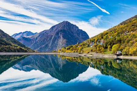 The lower reservoir of Lac du Verney at Allemond in France. It is the largest hydroelectric power station in France. The waters of the lake mirror the mountain ranges surrounding the Eau d Olle valley Stock fotó