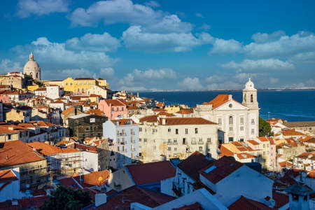 Sao Vicente de Fora Monastery and dome of the National Pantheon seen from Portas do Sol Belvedere with Alfama District rooftops. Lisbon, Portugal. Imagens