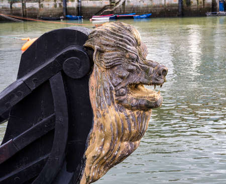 Decorative figure of a lion on the prow of an ancient sailboat at Bermeo in the Basque Country in Spain