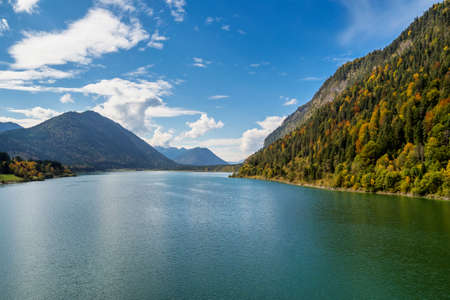 Sylvenstein reservoir lake in autumn, near Bad Toelz, Bavaria, Germany, Europe