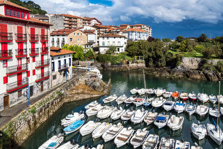 View of the Port of Mundaka located at the mouth of the Urdaibai Ria in the Bay of Biscay in the Basque country, Spain. Mundaka is famous for its surfing.