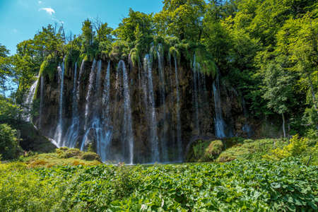 Majestic view on waterfall with turquoise water in the Plitvice Lakes National Park, Croatia. Europe. One of the oldest and largest national parks in Croatia. 免版税图像