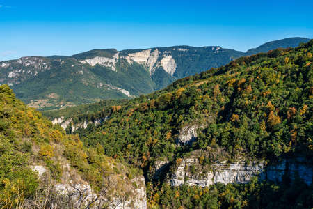 French countryside at Saint Martin le Colonel. Panoramic view of the heights of the Vercors, the marly hills and the valley Val de Drome, France