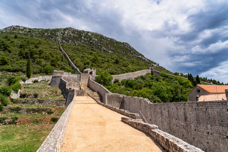 The second longest city wall in the world after the Great Wall of China. One of the major tourist attractions in Southern Croatia. Ston small town near Dubrovnik with old salt pans still in use.