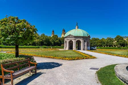 Munich, Germany - Jul 27, 2020: Hofgarten Park with Dianatempel in Munich. The Diana Pavilion and the grounds of the Hofgarten, adjacent to the Munich Residenz and Odeonsplatz.