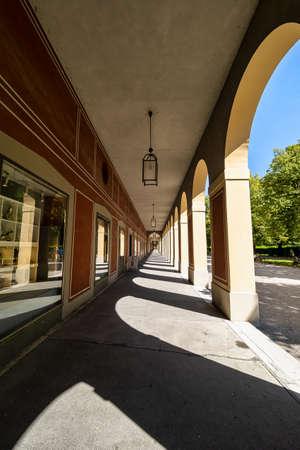 Munich, Germany - Jul 27, 2020: Promenade with long arcade columns surrounding Hofgarten Park in Munich, Germany in Europe