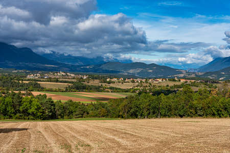 Scenic view on the Trieves valley with the Vercors mountain range near Bourg Saint Maurice village from the top of the Menil mountain, Rhone-Alpes, France