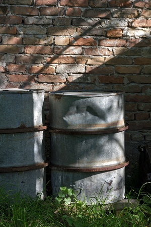 Metal barrels in a house yard used to collect rainwater Stock Photo - 13499219