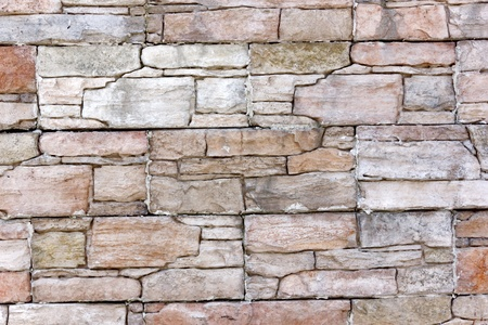 Gray stone wall � Wall made of stone blocks of various colors as background photo