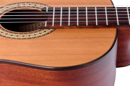 escarapelas: Cuerdas de una guitarra cl�sica y rosetas alrededor de la boca de la guitarra. Foto de archivo