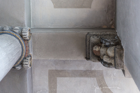 in a historical city of bavaria in south germany at summertime you see ornaments and candleholders and ceilings as well as benches and wall boards and door lock artwork Stock Photo