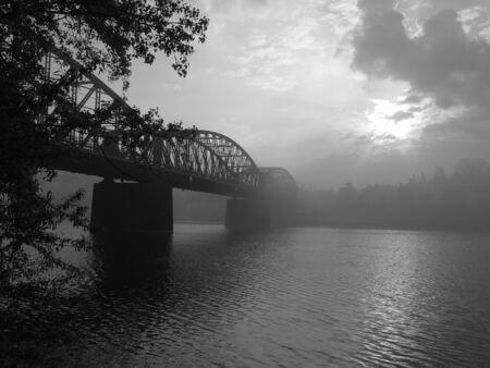 Railway bridge in Prague in the foggy morning photo