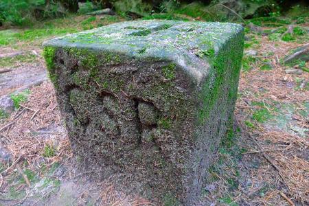 czechoslovak: Boundary stone on the former Czechoslovak border in Bohemian Switzerland Stock Photo