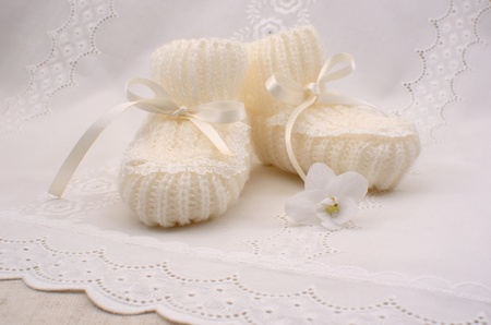 bootees: white booties for a newborn Stock Photo