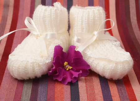 white booties for a newborn photo