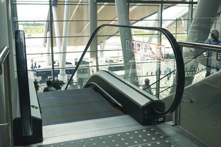 Airport Platov, Russia - 24.05.19: clean escalator closeup at the airport. beautiful modern escalator top down view