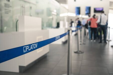 Airport Platov, Russia - 24.05.19: blue ribbon restriction of movement for people before check-in at the airport.