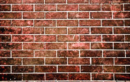 グランジ スタイルの赤レンガの壁
