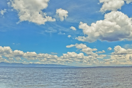 A fantastical photo of clouds over a seascape.  Stock Photo